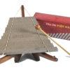 dan da stone instrument in box